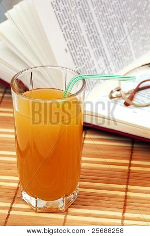 Multifruit Juice With Book And Glasses