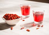Infusion Of Goji Berries With Dry Berries poster
