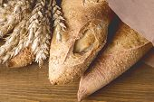 Tasty Crusty Baguettes On Wooden Background Tasty Homemade Bread Above Close Up Toned poster