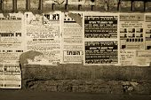 stock photo of tora  - hasidic jews walking in front of propaganda panels - JPG