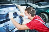 auto repairman grinding automobile body poster