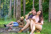 Friends Relaxing Near Campfire After Day Hiking Or Gathering Mushrooms. Summer Vacation Forest. Comp poster