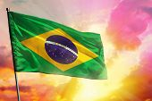 Fluttering Brazil Flag On Beautiful Colorful Sunset Or Sunrise Background. Brazil Success And Happin poster