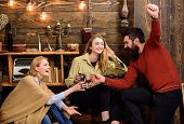 Company Of Friends Celebrate With Mulled Wine In Cozy Atmosphere, Wooden Background. Cheers Concept. poster