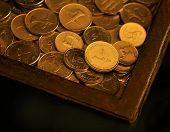 image of dirhams  - An UAE one Dirham coin in a wooden box - JPG