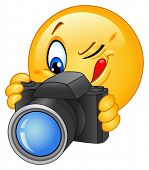 stock photo of smiley face  - Emoticon taking a photo - JPG