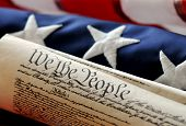 stock photo of betsy ross  - The US Constitution wrapped with a US flag - JPG