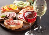 Rose and white wine with brushetta or traditional spanish tapas. Appetizers italian antipasti snacks poster