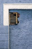 Old Metal Cooling Grill On A Textured Building Wall, Colorful Stains. The Layers Of Paint Exfoliate, poster