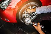 Asian Man Car Inspection Measure Quantity Inflated Rubber Tires Car.close Up Hand Holding Machine In poster
