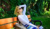 Woman Blonde With Sunglasses Dream About Vacation, Take Break Relaxing In Park. Girl Sit Bench Relax poster
