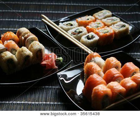 Japanese sushi on black plate