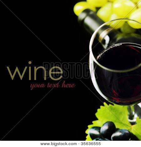 Glass of  wine and grape on black background  (easy removable sample text)