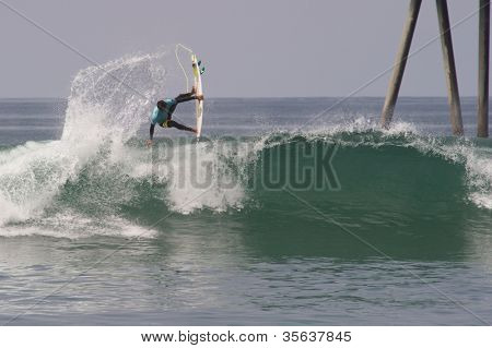 HUNTINGTON BEACH, CA - AUGUST 2: Miguel Pupo competes in the Nike US Open of Surfing in Huntington Beach, CA on August 2, 2012