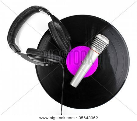 Black vinyl record with headphones and microphone isolated on white