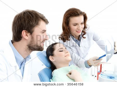 The patient thoroughly examines the x ray photo of the teeth. She is happy that everything is ok