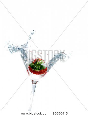 splashing strawberry into a martini glass