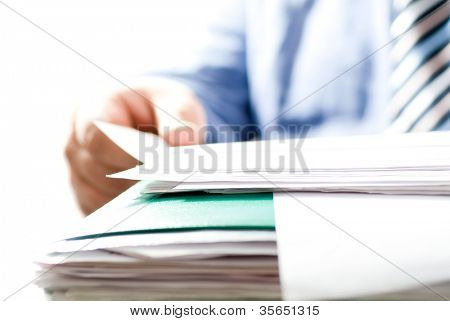 businessman reading contracts. Small DOF