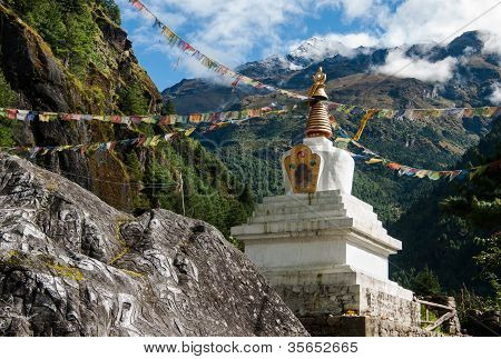 Buddhist Stupe Or Chorten With Prayer Flags In Himalayas