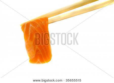 A piece of salmon fish meat in chopsticks