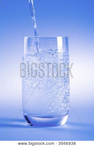 A Glass Of Dinking Water Isolated On Blue