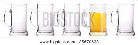 Empty And One Full Beer Glass Isolated