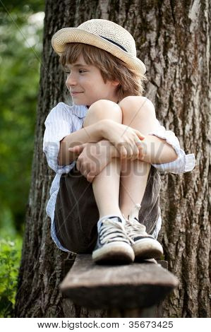 Fair-haired Boy In Sneakers