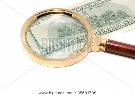 Banknotes through a magnifier. Isolation.