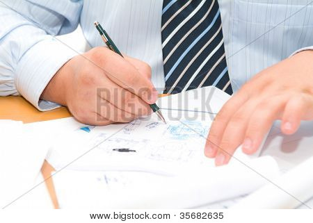 Business accessories on a background of diagrams.