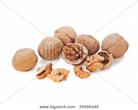 Walnuts And A Cracked Walnut Isolated On The White Background