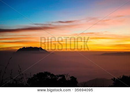 Colorful Summer Morning With Golden Light And Fog Between Hills
