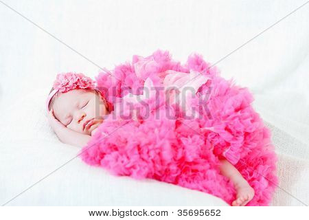 sleeping small princess in pink laces