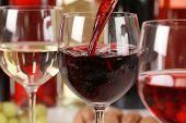 foto of bordeaux  - Red wine pouring into a wine glass - JPG