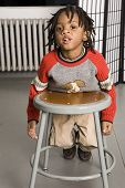 Cute Kid With A Stool poster
