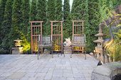 stock photo of metal sculpture  - Garden Paver Patio with Trellis Japanese Stone Lantern Pagoda and Bronze Crane Sculpture - JPG