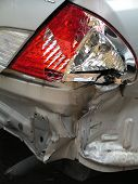 Automobile Accident Showing Smashed Rear Tail Light