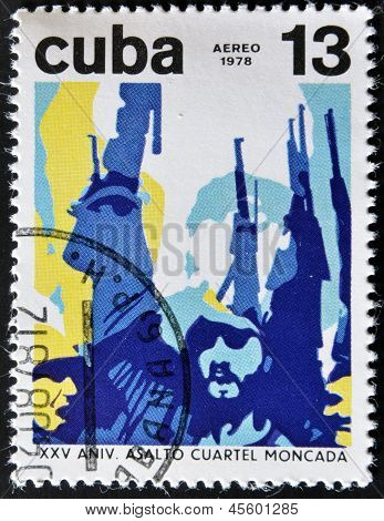 A stamp printed in Cuba shows Fidel Castro with rifle raised celebrating the assault on the Moncada