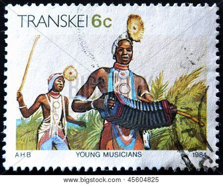 REPUBLIC OF SOUTH AFRICA - CIRCA 1984: A stamp printed in Transkei shows young musicians circa 1984