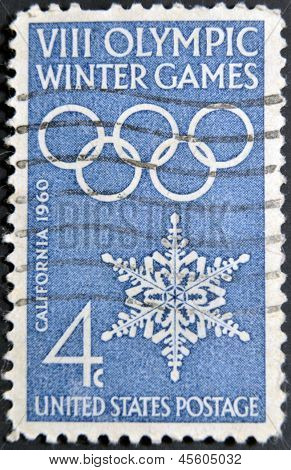 A stamp printed in USA shows image of the dedicated to the 8 Olympic Winter Games California