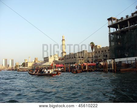 Abra boats crossing Dubai creek between Bur Dubai and Deira