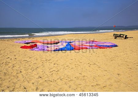 Colorful Paraglider Parachute Flat On Sandy Beach