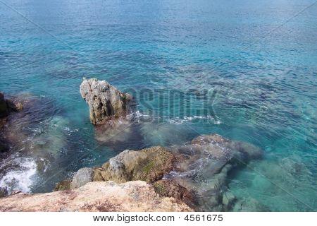 Cliff In Sea.