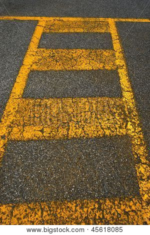 Old Asphalt And Yellow Lines