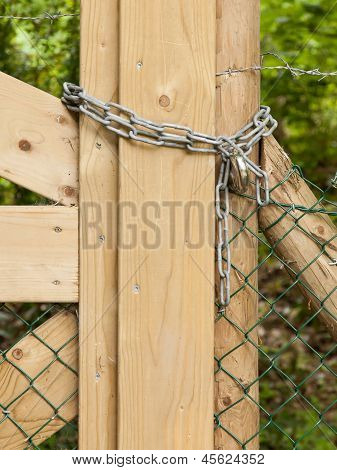 Chain Hanging On A Abandoned Gate