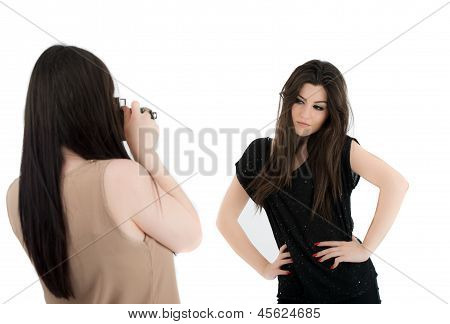 Two Beautiful Young Woman Watching Pictures On A Camera