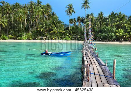 landscape of tropical island beach with beautiful wooden jetty