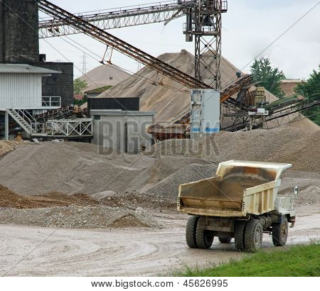 Huge Truck With Tipper In A Open Pit Mine In An Industrial Area