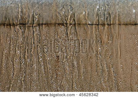 Fountain Drops Of Pure Brilliant Water Brown Background