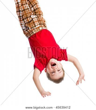 kid boy upside down isolated on white