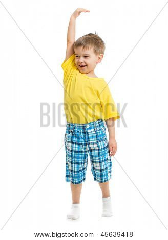 Kid demonstrating growing. Isolated on white studio shot.